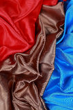 Brown and red and blue Silk cloth of wavy abstract backgrounds Stock Images