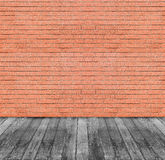 Brown red brick wall and black wooden floor Stock Photos