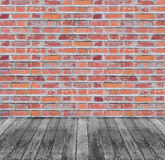 Brown red brick wall and black wooden floor. Background Stock Photo