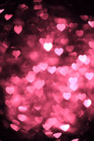 Brown red color heart bokeh background photo. Abstract holiday, celebration backdrop. Royalty Free Stock Images