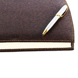 Brown red leather notebook with pen Royalty Free Stock Photography