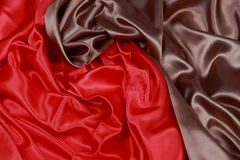 Brown and red silk satin cloth of wavy folds texture background Stock Photo