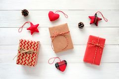 Brown and red vintage gift box and ornament on white wood background, Christmas, new year, valentine`s day and anniversary. Greeting card stock photography