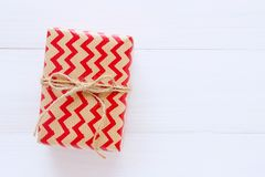 Brown and red vintage gift box white wood background with copy s stock photography