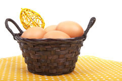 Brown reed basket with Easter eggs and decoration Royalty Free Stock Images