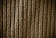 Brown regular striped and woven material background or texture Royalty Free Stock Images