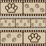 Brown retro background with film strips and pet paws, seamless pattern Stock Images