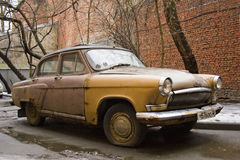 Brown retro car. Brown rusty retro car with round headlights Stock Photo