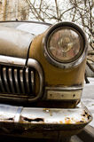 Brown retro car. Brown rusty retro car with round headlights Stock Photography