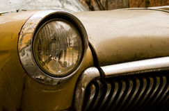 Brown retro car. Brown rusty retro car with round headlights Royalty Free Stock Photography