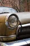 Brown retro car. Brown rusty retro car with round headlights Royalty Free Stock Images