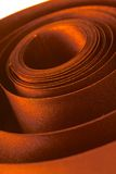 Brown ribbon. Brown curly satin ribbon close-up Stock Image