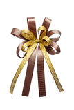 Brown ribbon bow isolated on white background. Brown and gold ribbon bow isolated on white background Royalty Free Stock Photos