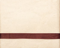 Brown Ribbon Over Vintage Gift Old Paper Background Royalty Free Stock Images