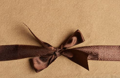 Brown ribbon on yellow background Royalty Free Stock Images
