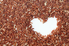 Brown rice. With heart shape Stock Photo