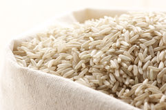 Brown rice in bag Stock Photography
