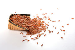 Brown rice. In basket, white isolate Stock Photo