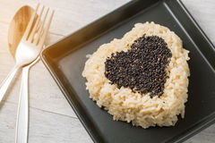 Brown rice and black sesame heart shape Royalty Free Stock Photography