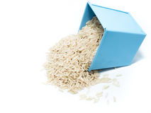 Brown rice in blue tin bucket stock photography