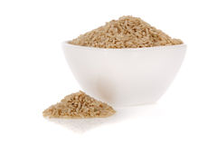 Brown rice in a bowl isolated on white Stock Image