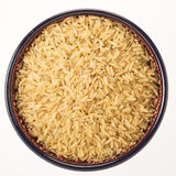 Brown Rice in Bowl Isolated Stock Photography