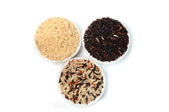 Brown rice in bowls. Many Brown rice varieties in bowls Stock Photography