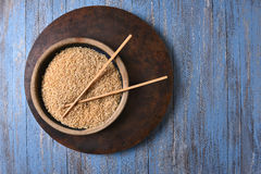 Brown Rice and Chop Sticks Stock Photography