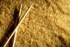 Brown rice and chopsticks Royalty Free Stock Images