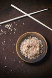 Brown rice with chopsticks Royalty Free Stock Photos