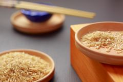 Brown rice on clay plates Stock Images