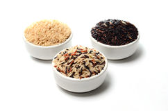 Brown rice in cup. Brown rice in 3 cup Royalty Free Stock Photo