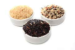 Brown rice. In 3 cup Royalty Free Stock Images