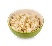 Brown rice in a cup Stock Images