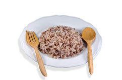 Brown rice dish cooked in white paint on a white background isol Stock Photos