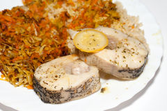 Brown rice with fisch and vegetable. The healthy diet - brown rice with fisch and vegetable royalty free stock images