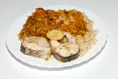 Brown rice with fisch and vegetable. The healthy diet - brown rice with fisch and vegetable stock photos