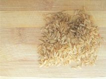 Brown rice heap Stock Images