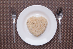 Brown rice. Heart shape as whiteplate Stock Photo