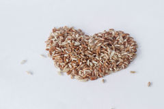 Brown rice in heart shape Stock Photos