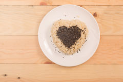 Brown rice heart shape on white plate Royalty Free Stock Images