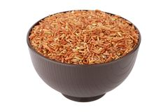 Brown rice. Isolated over white background Stock Photography