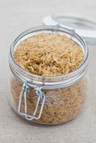 Brown rice in a large glass jar Stock Photos