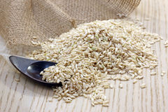 Brown rice. Brown natural rice on the table Royalty Free Stock Image