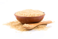 Brown rice over the spoon Stock Photography