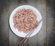 Brown rice in a plate Stock Photos