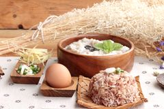 Brown Rice Porridge Put Pork And Brown Rice With Soft-boiled Egg Stock Image