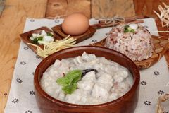 Brown rice porridge put pork and brown rice with soft-boiled egg Royalty Free Stock Images