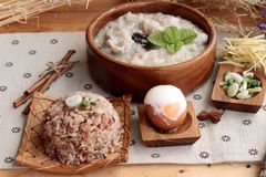 Brown rice porridge put pork and brown rice with soft-boiled egg Royalty Free Stock Photo
