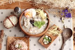Brown rice porridge put pork and brown rice with soft-boiled egg Royalty Free Stock Image